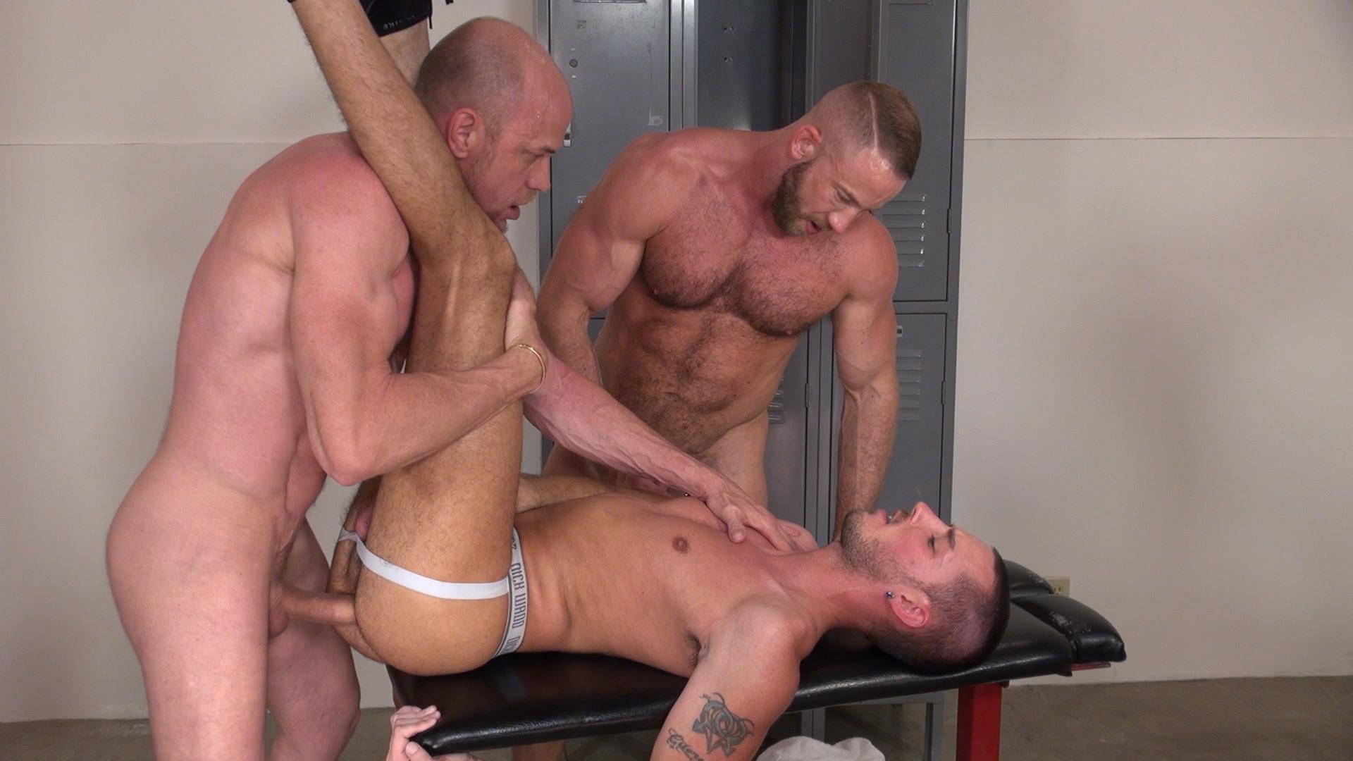 jock gets spitroasted by two kinky cocks